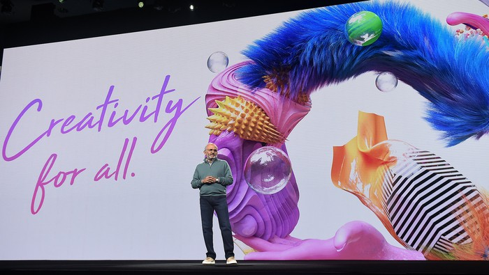 "Shantanu Narayen in front of a slide that says ""Creativity for all"""
