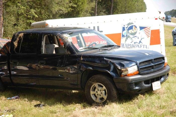 Photo of crashed truck and Uhaul trailer.