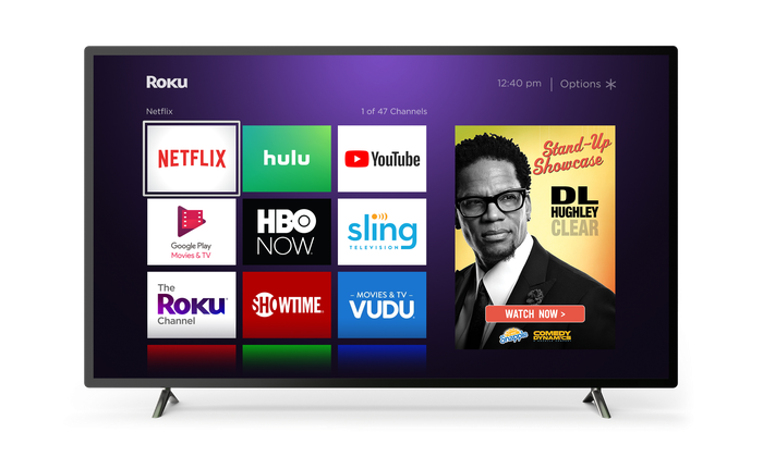 A smart TV running Roku's operating system with several apps and an ad on the home screen.