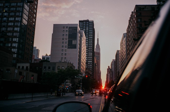 A view of a downtown cityscape from outside a car window.