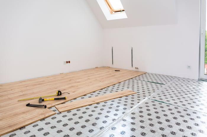 A hardwood floor being installed over tile.