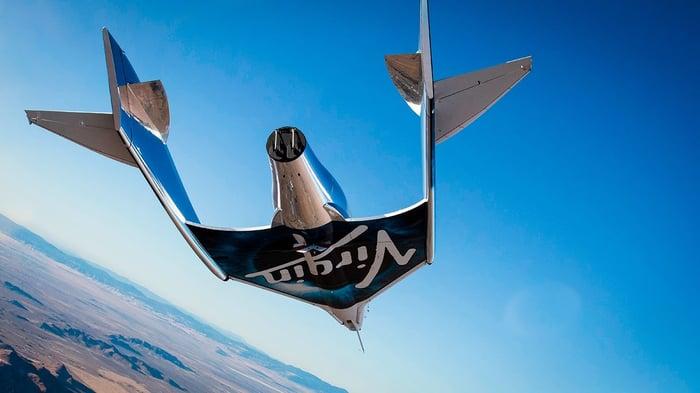 Virgin Galactic's VSS Unity flying in a clear blue sky.