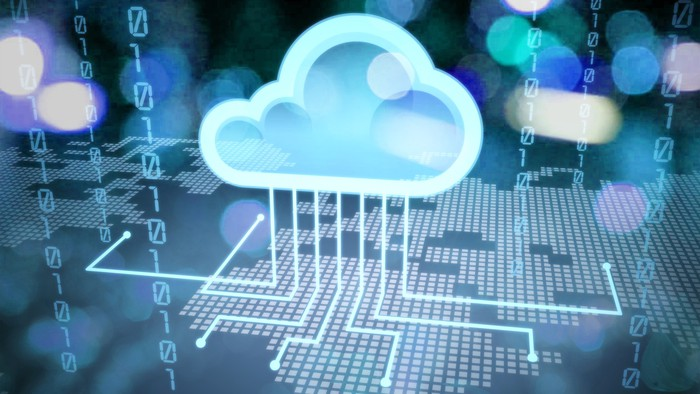 A digital circuit board with a cloud over it
