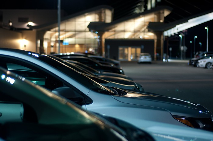 a row of cars at a car rental area