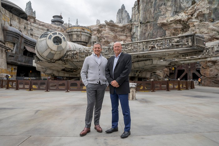 Disney's Bob Iger and Bob Chapek standing in front of the Star Wars attraction at Disneyland.