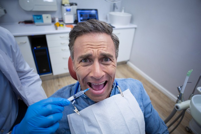 Scared guy at the dentist.
