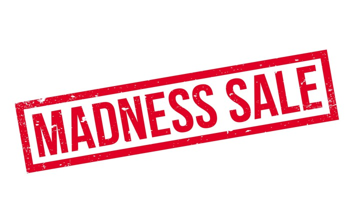 A red rubber stamp that says madness sale.