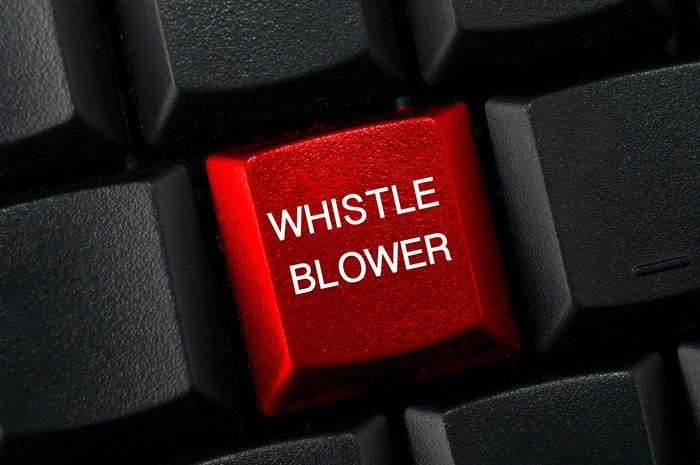 Computer key labeled whistleblower