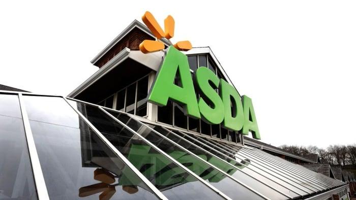 Asda sign atop store