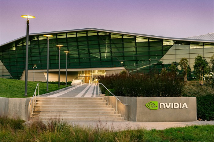 Large office building with the NVIDIA corporate logo displayed on a wall near the entrance.