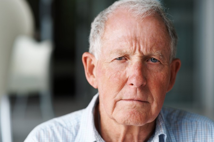 Close-up of older man with serious expression