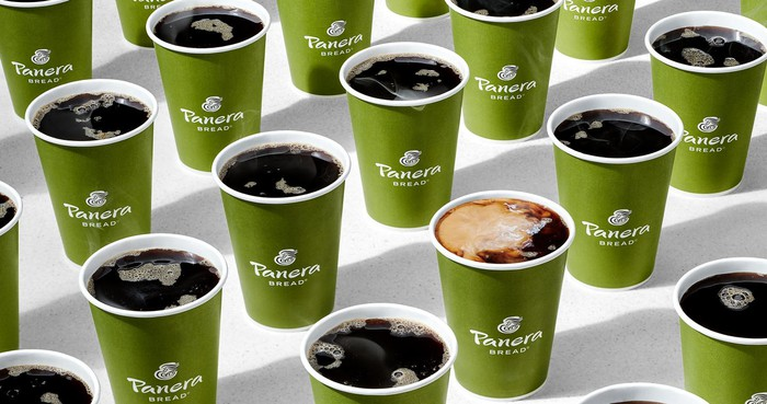 Panera's coffee cups are lined up.