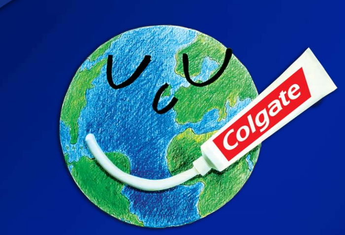 Globe with a face written on it, along with mouth in Colgate toothpaste.