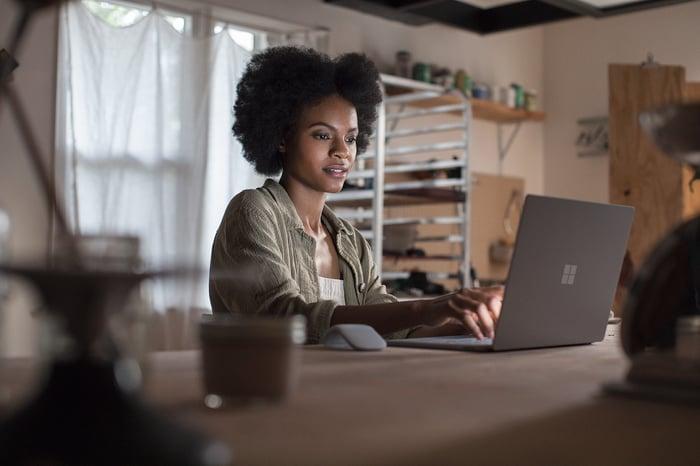 Woman using Surface Laptop