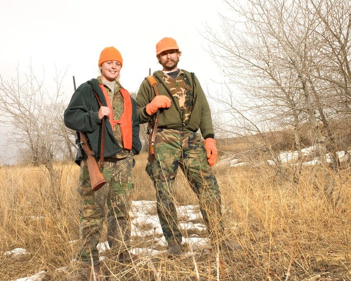 Two hunters standing in a field