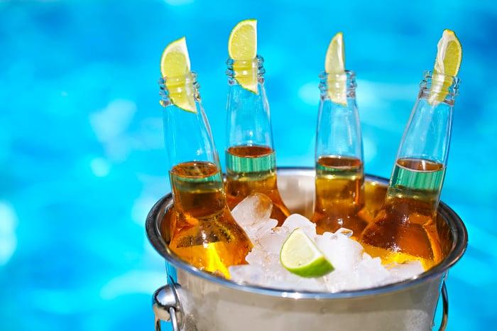 Bucket of beer bottles on ice
