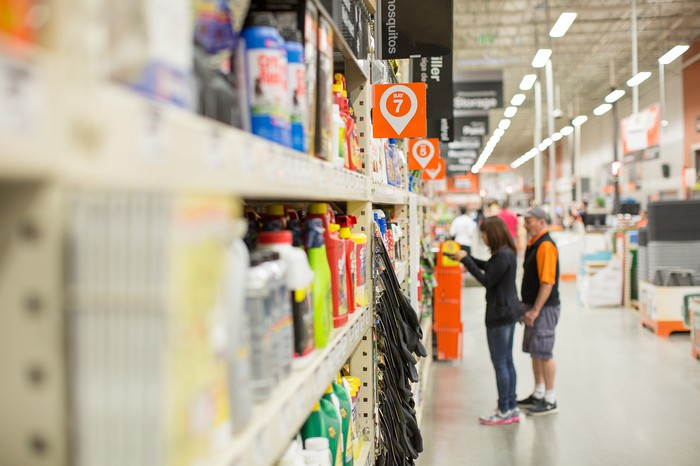 A worker interacts with a customer at Home Depot.