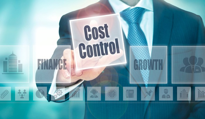 """Graphic of business man choosing a """"cost control"""" icon from a menu of choices"""