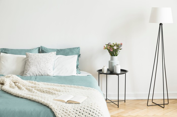 A bedroom set including a bed nightstand and a lamp