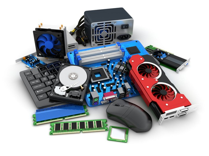 various pieces of computer equipment sit on a table