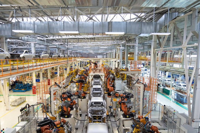 Photograph of automobile assembly plant.