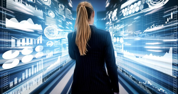 A woman walks through a tunnel with animations of  data and graphs flying by her on both sides.