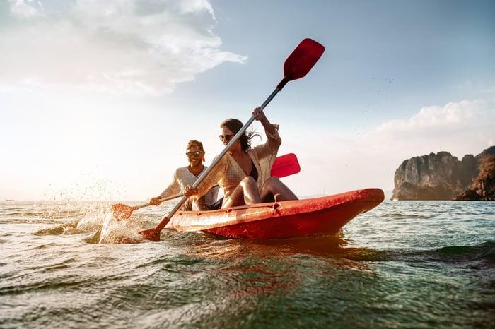 A couple kayaks on the open ocean.