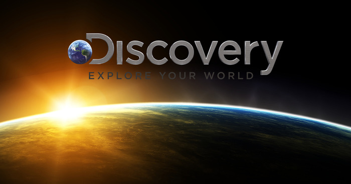 Discovery's logo above a picture of Earth from space