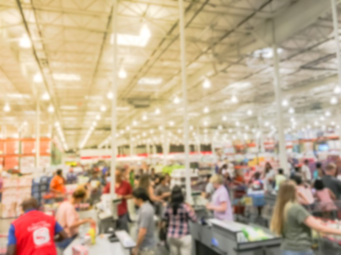 Busy retial store with hundreds of shoppers in checkout line