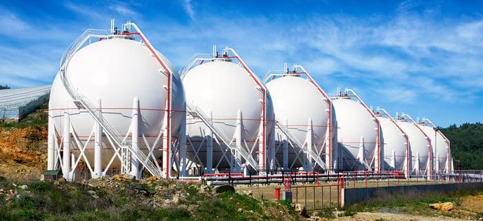 Seven pressurized gas tanks.