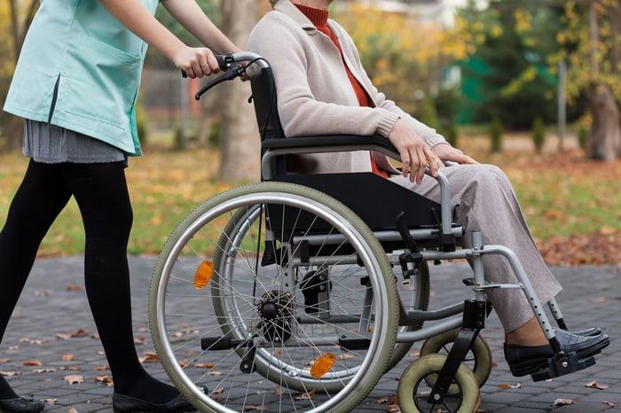 Older woman in wheel chair.