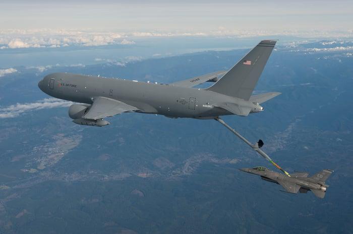 KC-46 tanker refueling an F-16 fighter