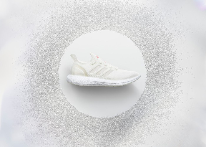 A white sneaker with the Adidas logo on the side.