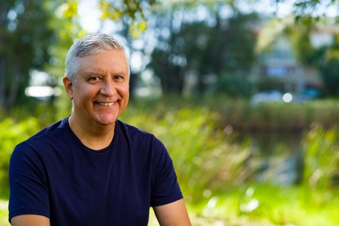 Smiling older man outdoors