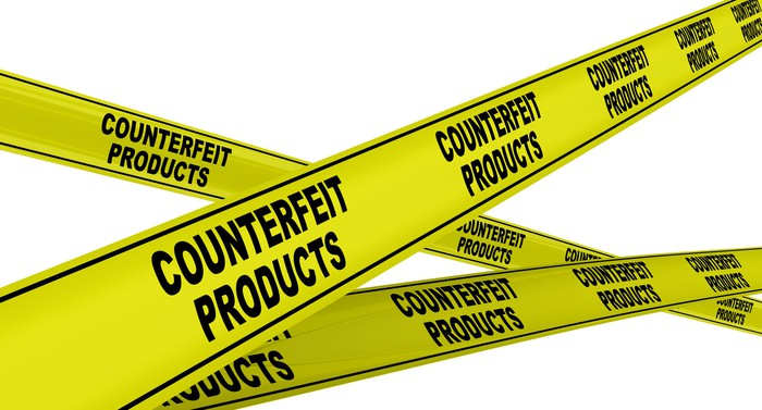 Yellow police tape that says counterfeit products.