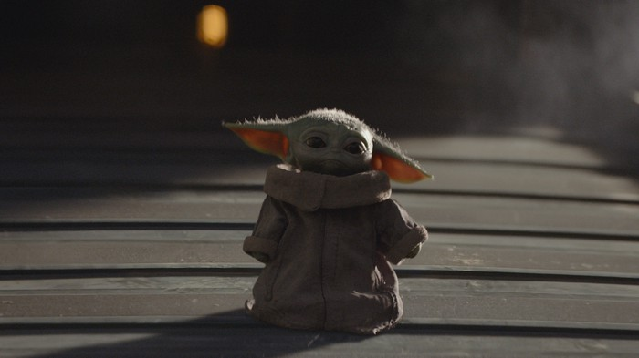 A scene featuring Baby Yoda in Disney's The Mandalorian.