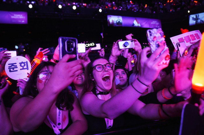 Crowds near a stage taking photos with phones at South by Southwest.