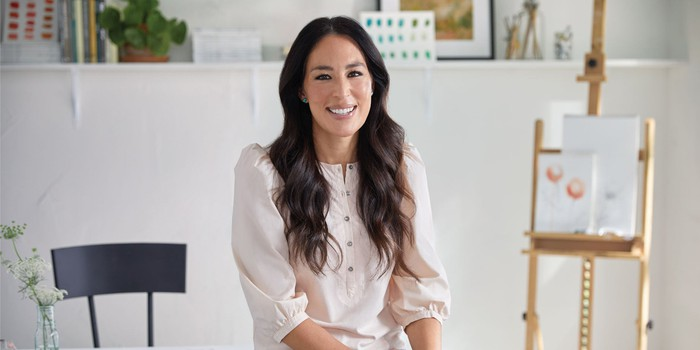 Joanna Gaines is sitting.