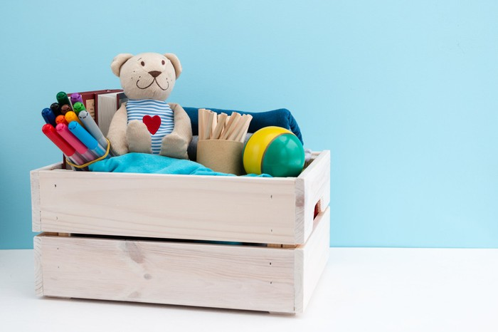 Toys in a wooden crate.