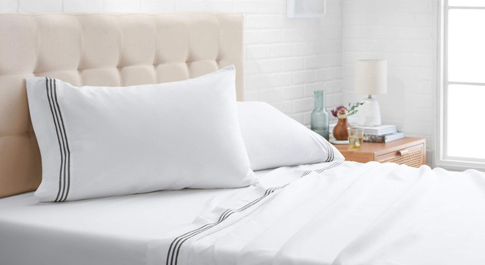 A bed is made using Amazon's bedding.