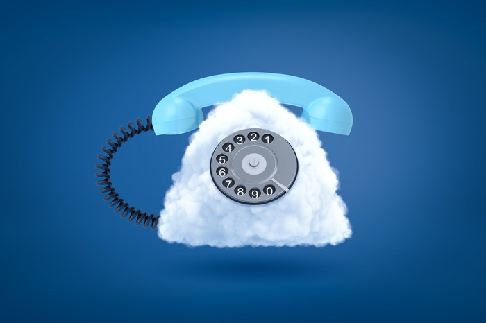 Digital rendering of an old-school rotary phone where the main casing is replaced by a fluffy white cloud.