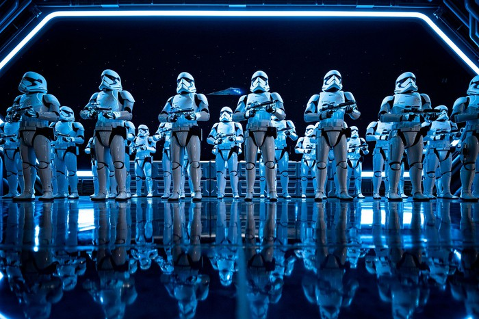 Storm troopers from star wars lined up on the deck of a space ship.