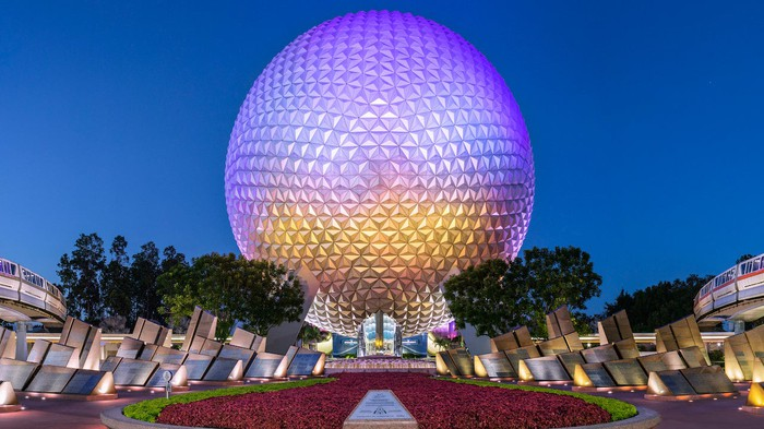 Epcot's signature landmark Spaceship Earth as night descends overhead.