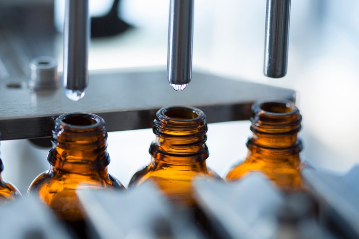 Bottles are filled with product on a pharmaceutical production line.