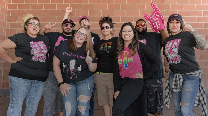 A group of young T-mobile employees in celebratory mode.