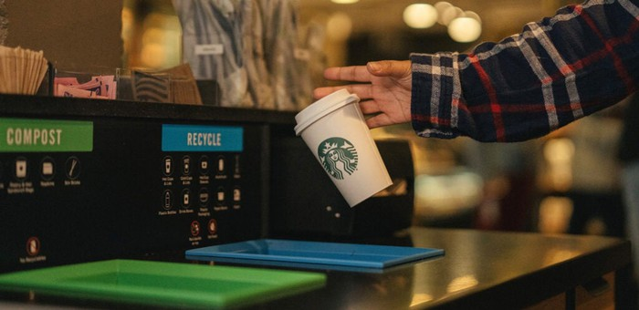 A Starbucks cup is being recycled