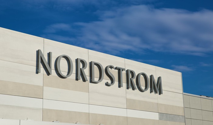 A close-up of the Nordstrom logo on the outside of a store.