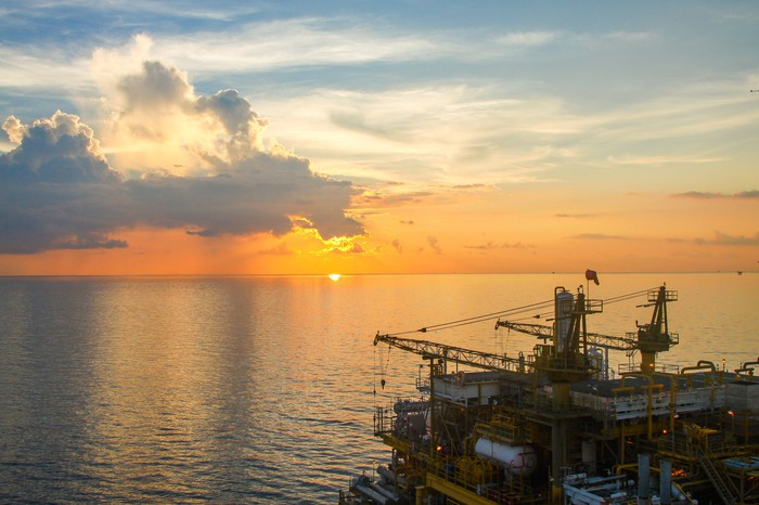 An offshore oil platform on the water.