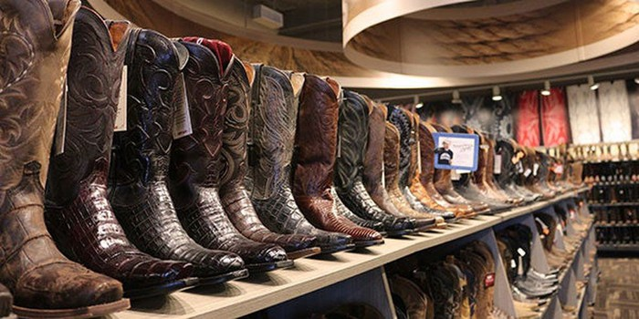 Shelves with boots on them.