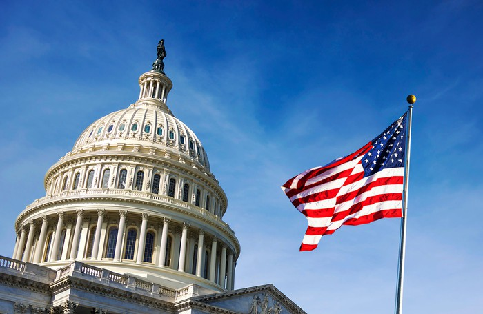 A picture of an American flag over Capitol Hill.